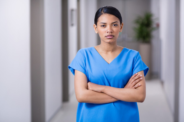 portrait-nurse-standing-with-arms-crossed_107420-75241